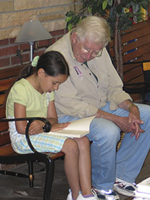 Student reading with a volunteer